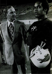 Simpson with Bills owner Ralph Wilson (Ebony, 1976)