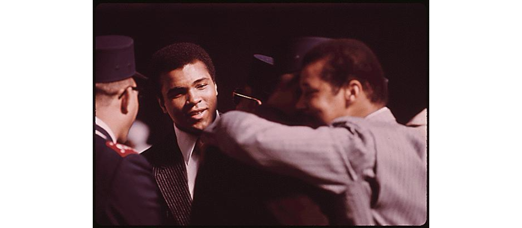 Muhammad Ali attends gathering to hear Elijah Muhammad deliver Savior's Day message, March, 1974