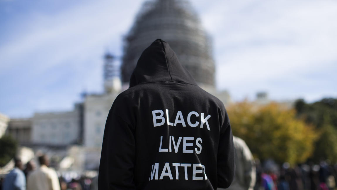 Neal Blair, of Augusta, Ga., stands on the lawn of the Capitol during an October rally to mark the 20th anniversary of the Million Man March. (Evan Vucci / Associated Press)