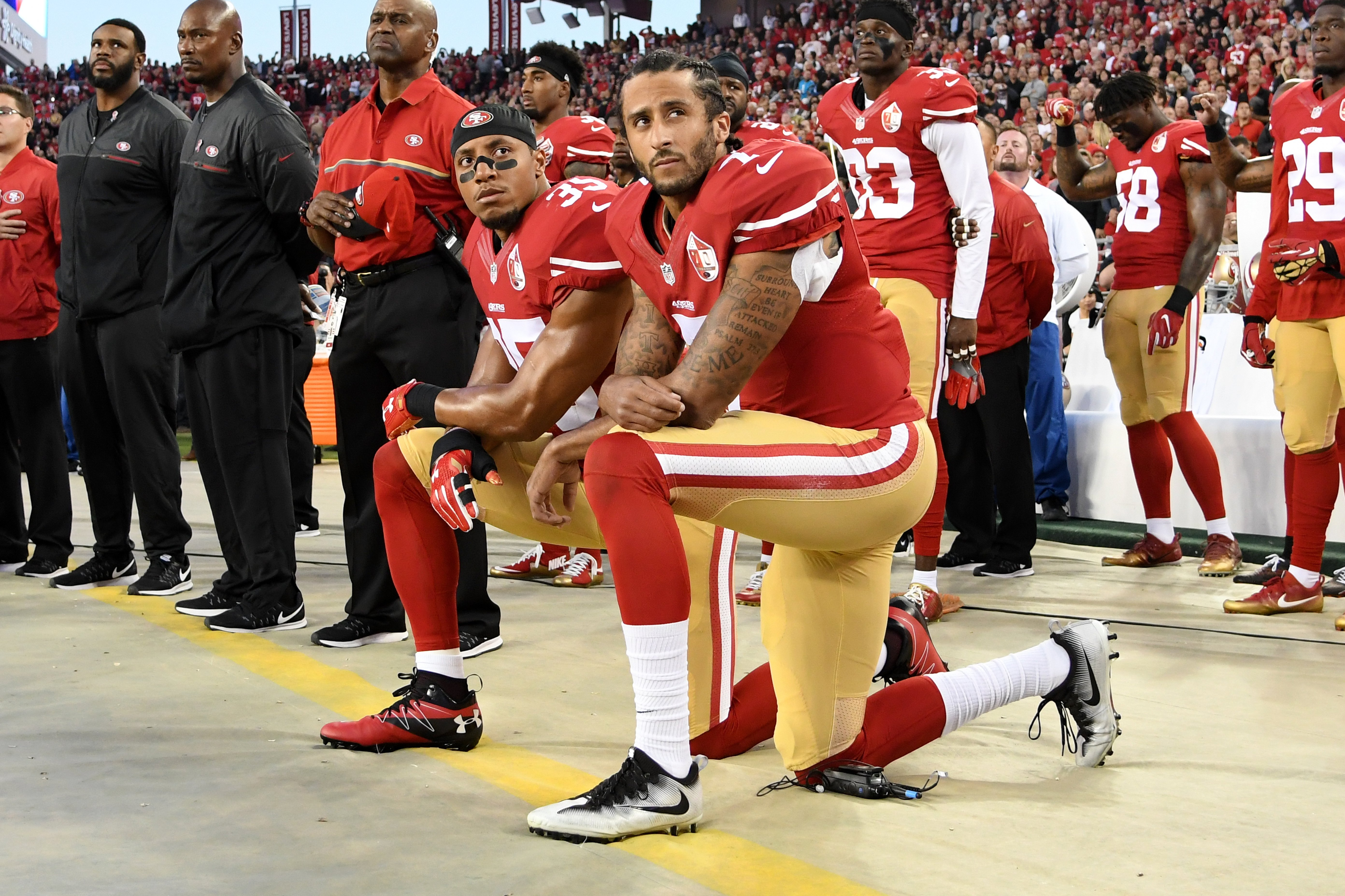 Colin Kaepernick and teammate Eric Reid kneel in protest during September 12, 2016 game against the Los Angeles Rams