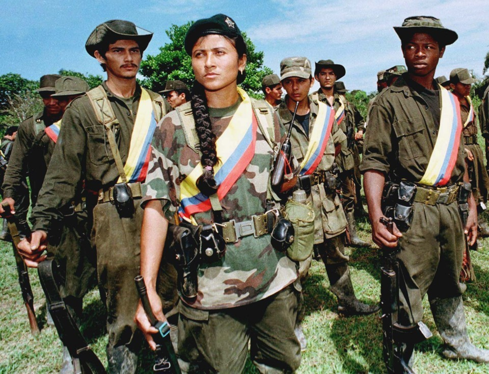Caption for Photo 1: FARC guerrilla fighters in 1998. Photo courtesy of The Atlantic.