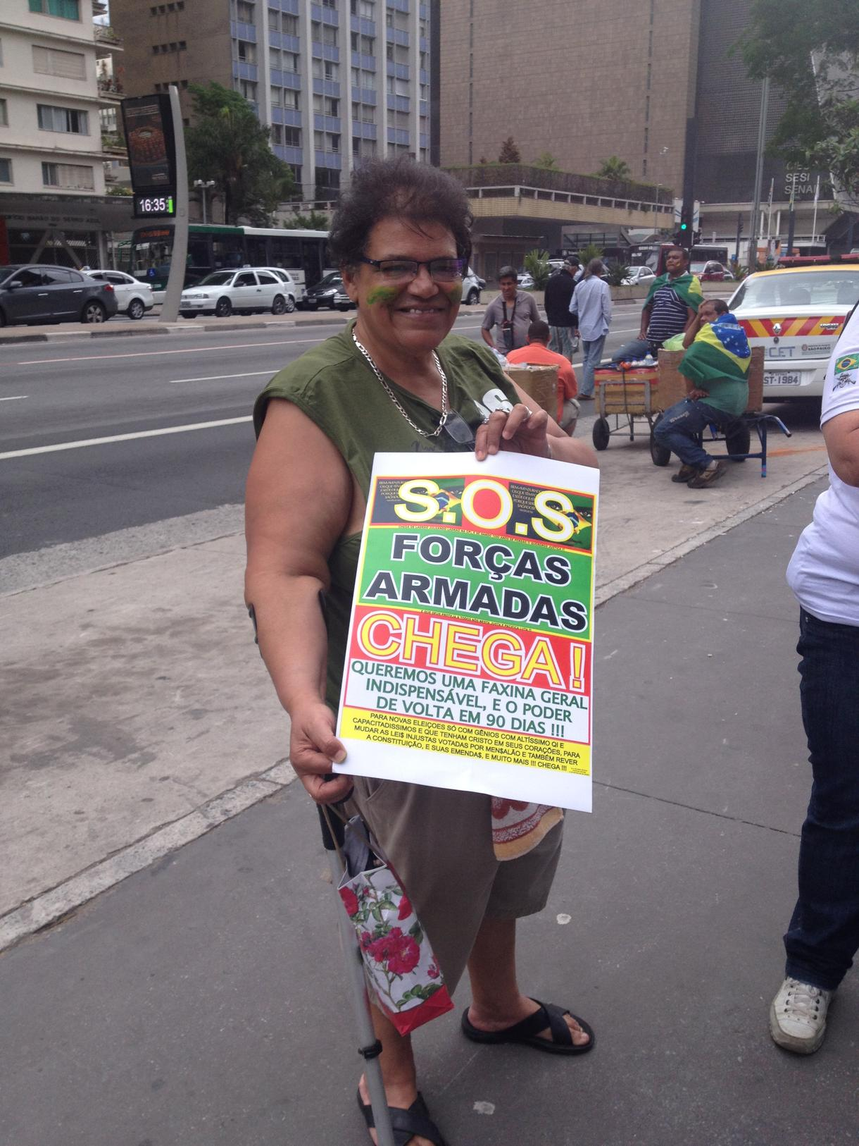 """Protesters calling for return to military government for 90 days. The placard in the picture reads:""""S.O.S. Armed Forces: Enough! We want a fundamental cleanup, and power back in 90 days.""""Photo courtesy of Vice News."""