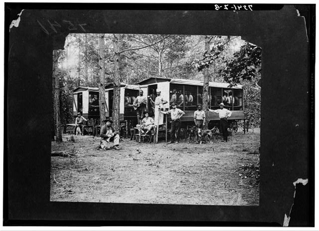 Convict laborers engaged in road work in Pitt County, North Carolina, in 1910. The wagon served as transport and lodging for the prisoners.