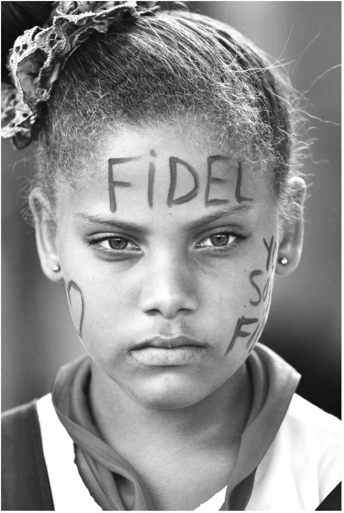 "A young girl in Santiago attending a memorial service for Fidel Castro. ""Yo soy Fidel"" (I am Fidel) face paint. Source: www.granma.cu."