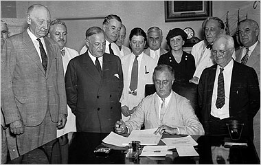 President Roosevelt signing Social Security into law, 1935. Source: New York Times.