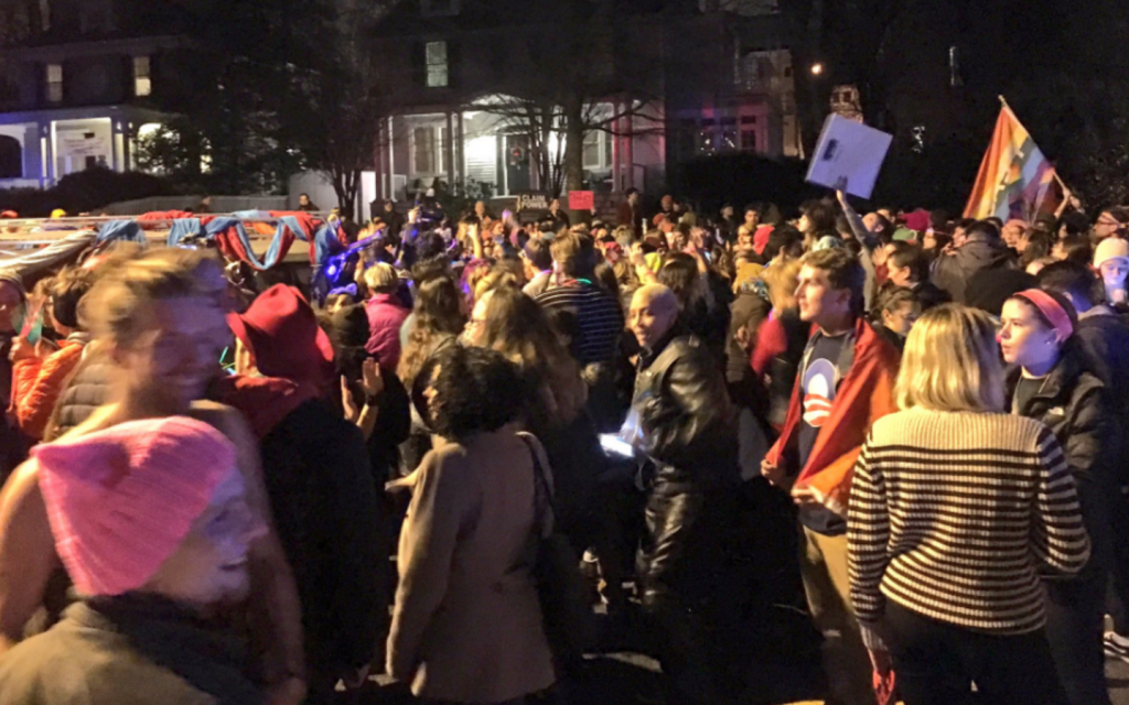 LGBTQ activists and others hold a dance party outside Mike Pence's home. Source: WJLA.