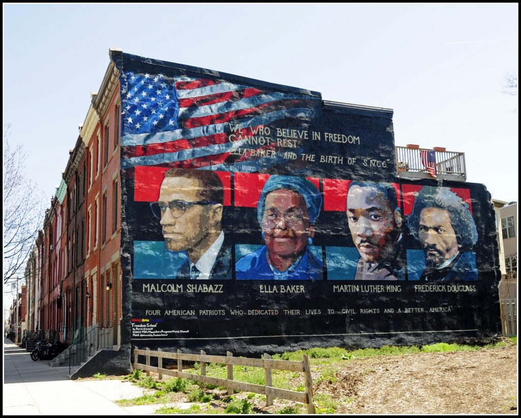 Mural in Philadelphia by Parris Stancell depicting Malcolm X, Ella Baker, Martin Luther King, and Frederick Douglass. Photo: Wikimedia.