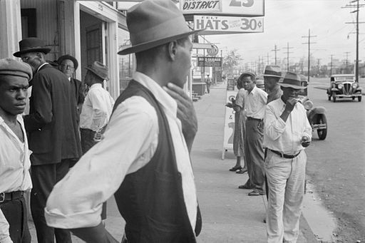 Applicants waiting for jobs in front of FERA offices, New Orleans, Louisiana, 1935. Photo: Wikipedia.