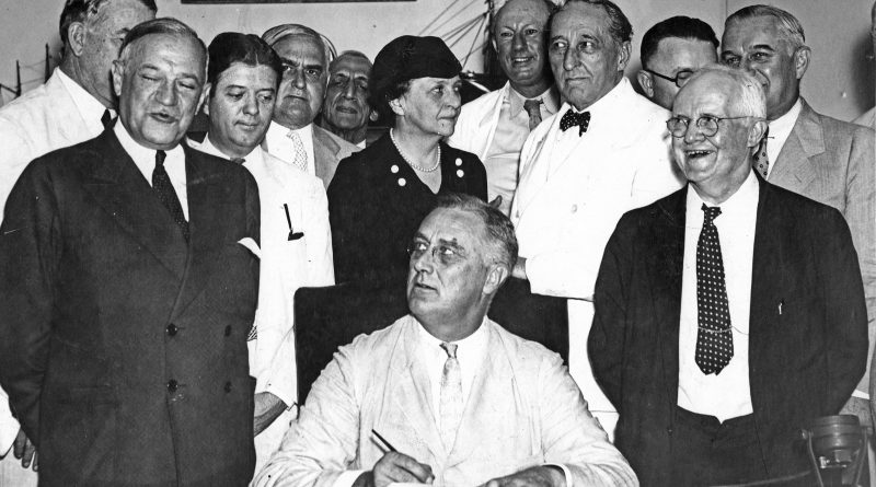 FDR signing the Social Security Act (1935). Photo: The Living New Deal.