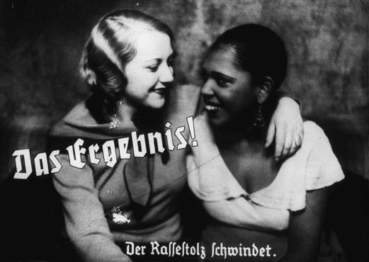 "Nazi propaganda photo depicts friendship between an ""Aryan"" and a black woman. The caption states: ""The result! A loss of racial pride. Photo: US Holocaust Memorial Museum."