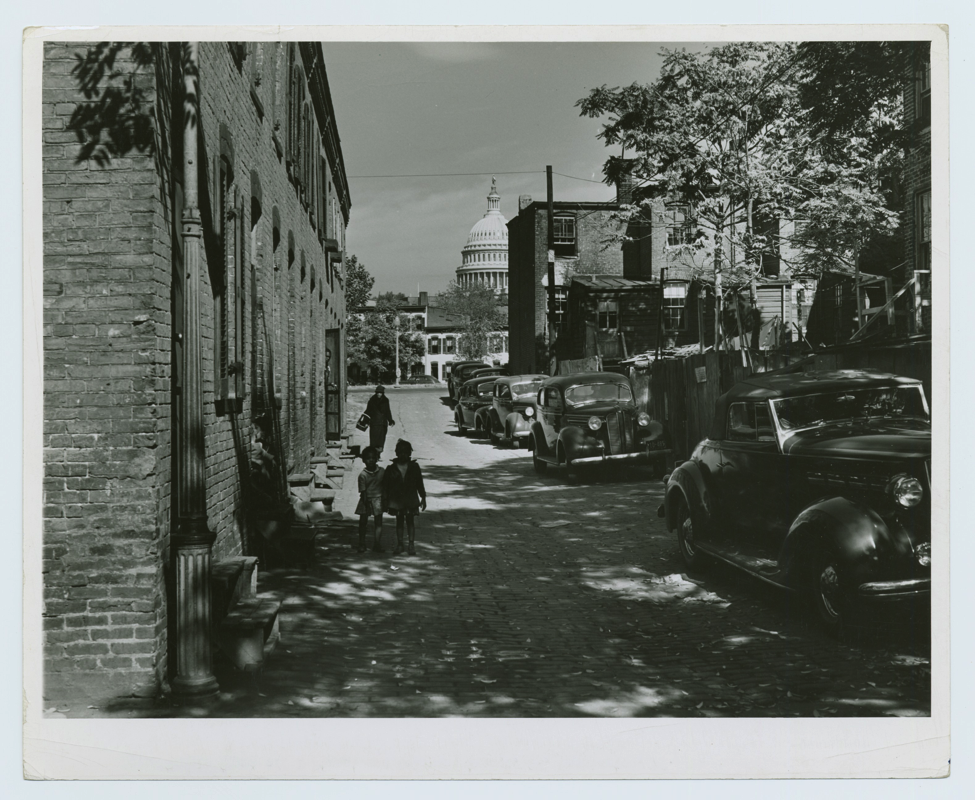 "Schomburg Center for Research in Black Culture, Photographs and Prints Division, The New York Public Library. ""Temple Court off D Street and Delaware, SW, Washington, D. C."" The New York Public Library Digital Collections."