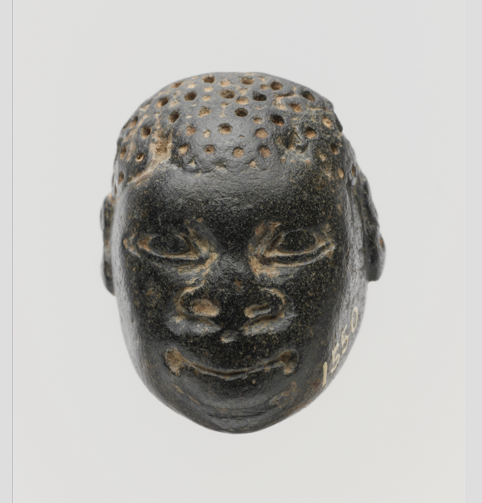 Chlorite pendant in the form of the head of an African (known as Ethiopian), Iron Age, 9th-8th century B.C., Cypriot. The Cesnola Collection, Accession no. 74.51.5010. Photo: Metropolitan Museum of Art.