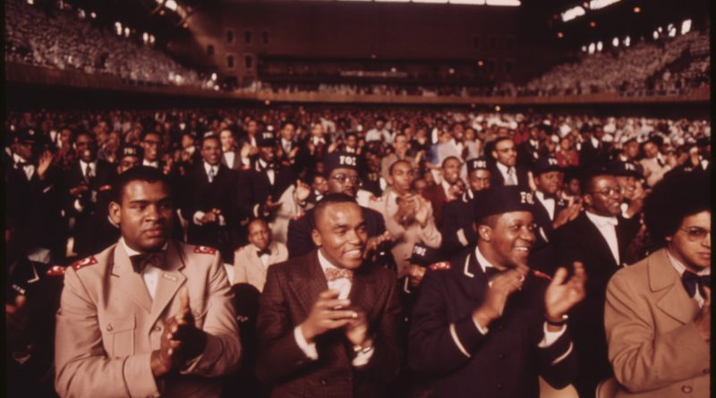 Crowd applauding Nation of Islam leader Elijah Muhammad in Chicago, 1974. Photo: Environmental Protection Agency/National Archives and Records Administration.