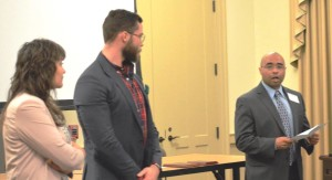 Following the keynote address, Chris Cameron delivers the Du Bois-Wells Graduate Student Papers Prizes to Annalisa Mogorovich (L) and Jonathan Lande (R)