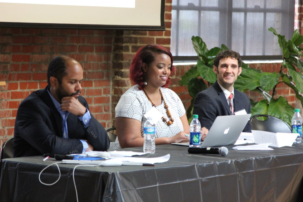 """Pedro Rivera, Assistant Professor of History, Savannah State University (L); Asia Leeds, Assistant Professor, African Diaspora and the World, Spelman College (C); and Jonathan Warner, graduate student, Indiana University, during their panel, """"Migratory Circuits, Migratory Visions."""""""