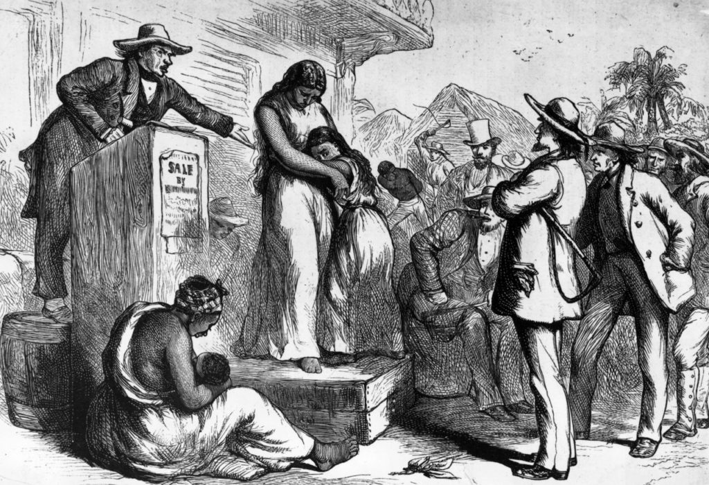 A slave auction. (Rischgitz/Hulton Archive)