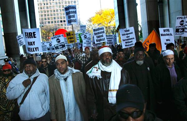 Muslim community members and supporters march near 1 Police Plaza to protest the New York Police Department surveillance operations of Muslim communities on Nov. 18, 2011, in New York. Bebeto Matthews / AP file