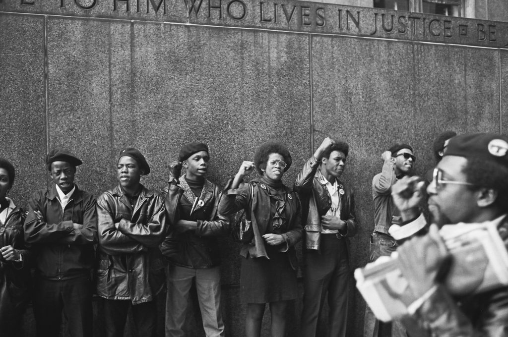View of a line of Black Panther Party members as they demonstrate, fists raised outside the New York City courthouse, New York, New York, April 11, 1969. (Photo by David Fenton/Getty Images)