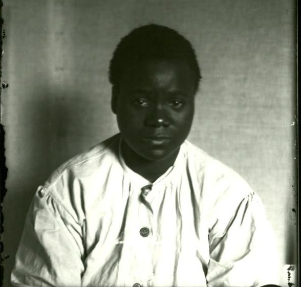 Photograph of Virginia Christian, first woman executed by the Commonwealth of Virginia. Convicted and sentenced to death for the murder of Ida Belote, her white employer, this photo of Christian was probably taken on June 3, 1912, when she was transferred from Hampton to the Virginia Penitentiary Death House in Richmond, Virginia.