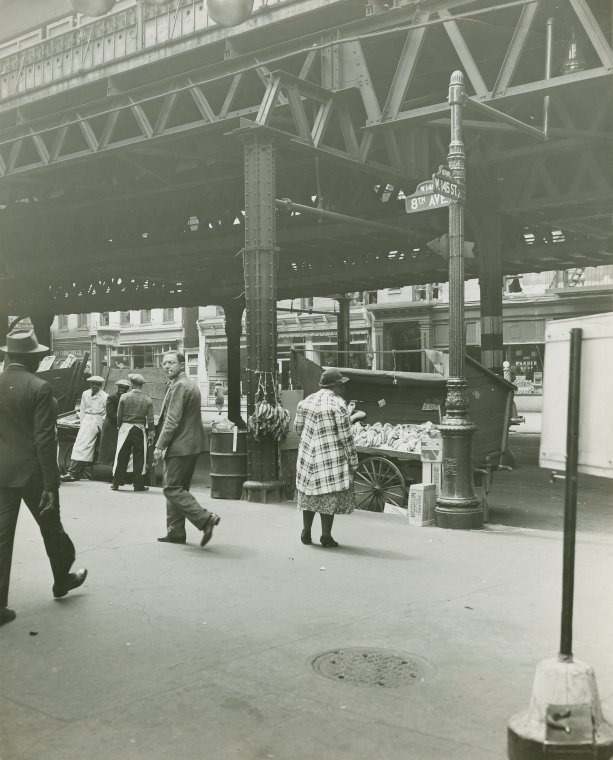 """""""Pushcart vendors under the 8th Avenue elevated train at West 145th Street, Harlem, May 8, 1939"""" (Credit: Schomburg Center for Research in Black Culture, Photographs and Prints Division, The New York Public Library)"""