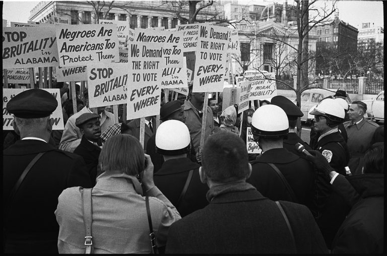 Demonstrators outside the White House hold signs demanding the right to vote and protesting police brutality against civil rights demonstrators in Alabama in March 1965. Credit: Library of Congress