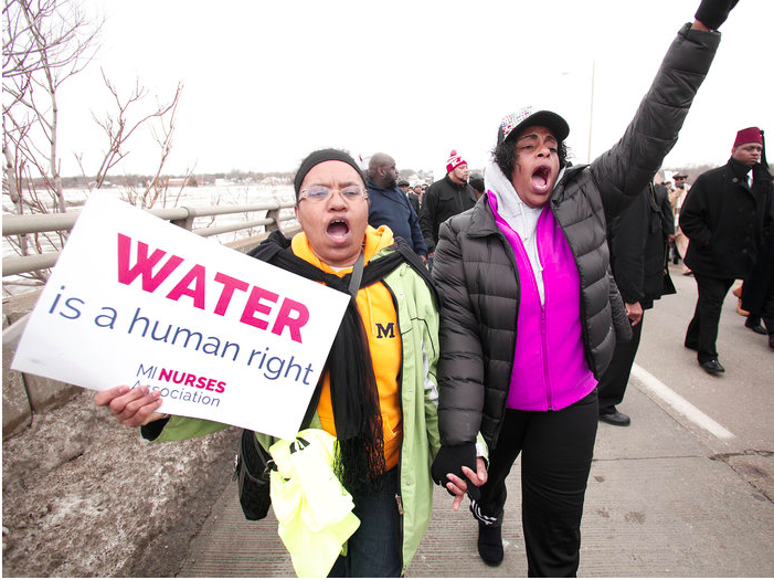 People participate in a national mile-long march in February to highlight the push for clean water in Flint, Mich. Bill Pugliano/Getty Images
