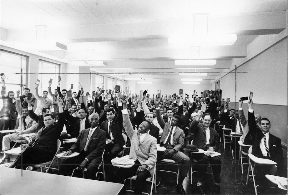 Black and Puerto Rican members of Local 10, ILGWU, before the public hearing at the New York State Commission for Human Rights, May 15, 1962, A. Philip Randolph is in the middle of the front row. (International Ladies Garment Workers' Union Records, Kheel Center, Cornell University)