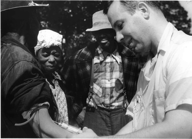 A doctor draws blood from one of the Tuskegee test subjects. Photo: Wikipedia.