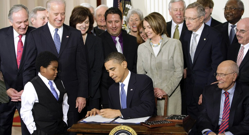 Former President Barack Obama signing the Affordable Care Act. Photo: Washington Post.